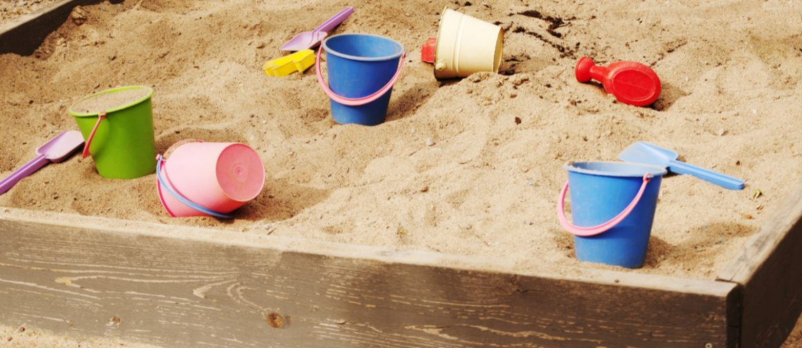 sand box with shovels and pails