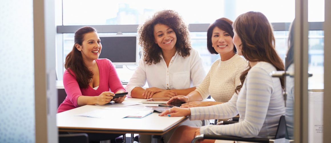 group of business women sitting at table