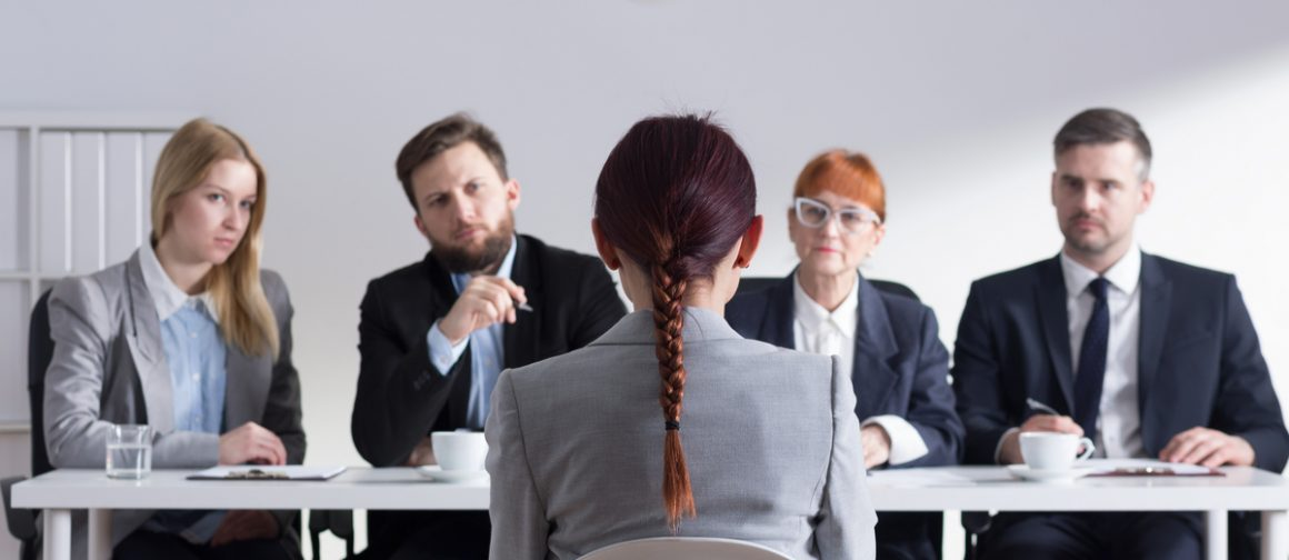 Woman during job interview and four members of management