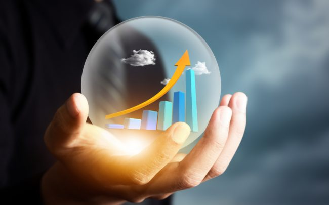 businessman holding increasing graph in crystal ball