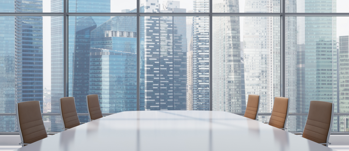 conference room table facing cityscape window