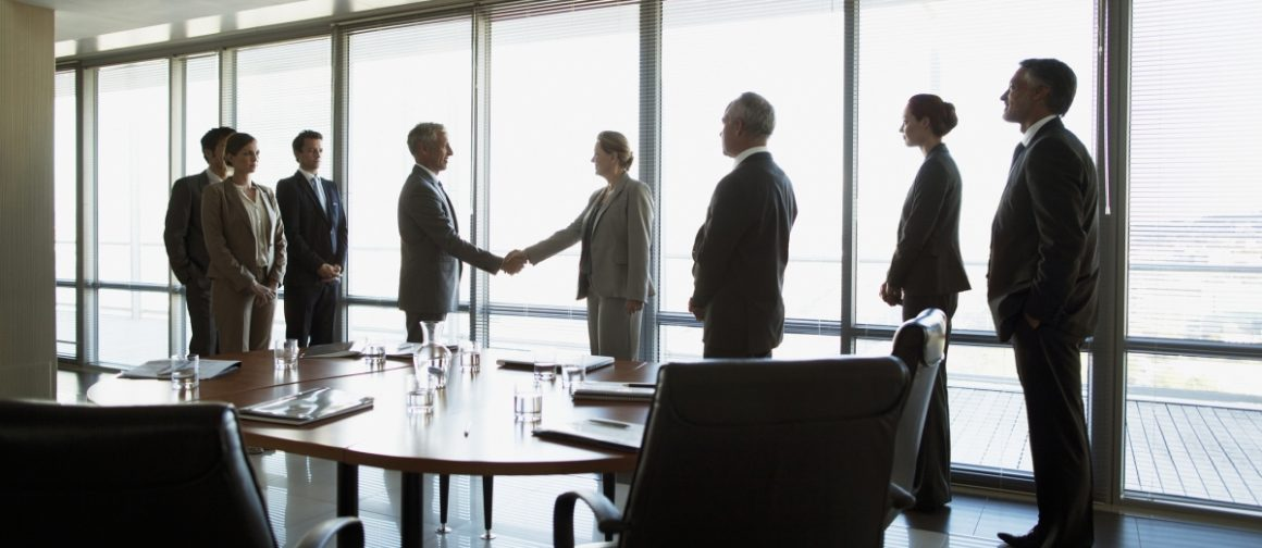 shaking hands at a business meeting