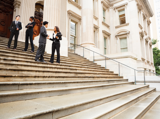 business people talking on building steps